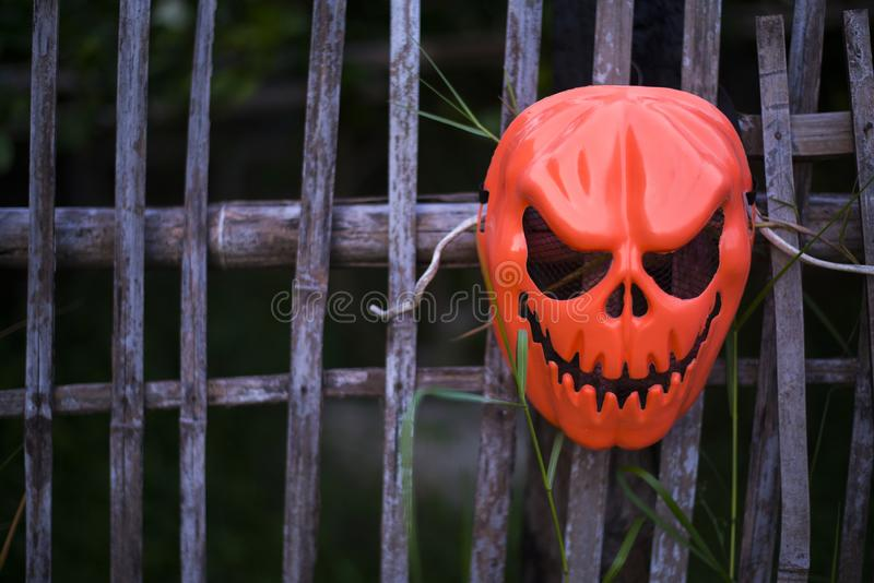 Devil mask hung on the fence. Halloween concept, Close-up royalty free stock photo