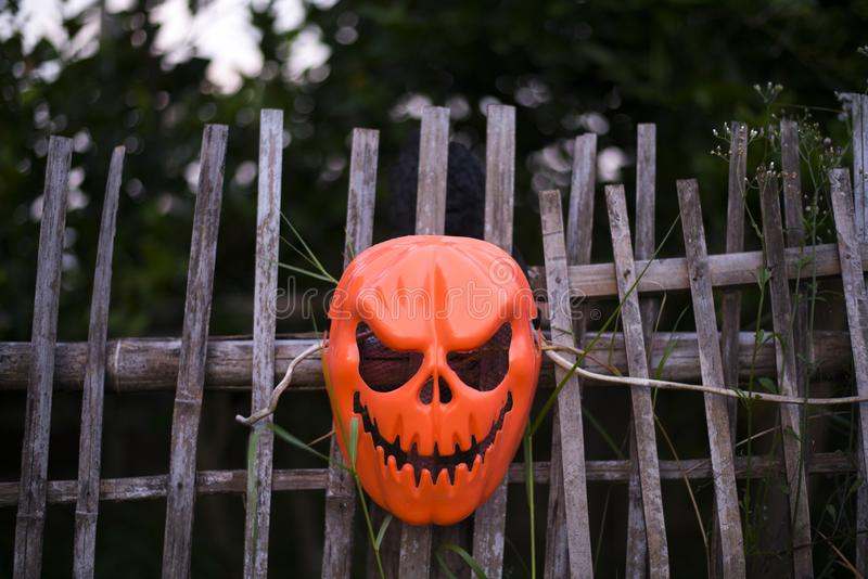 Devil mask hung on the fence. Halloween concept, Close-up stock photos