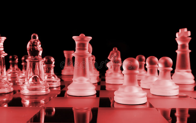 The Devil Plays Chess. The Devils Chess Set red on black royalty free stock image