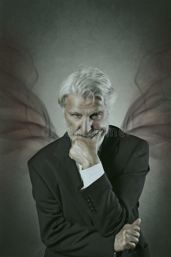 Devil portrait. Devilish portrait of a mysterious old man with sharp look royalty free stock image