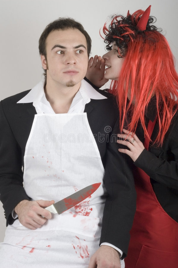 Devil & victim stock images