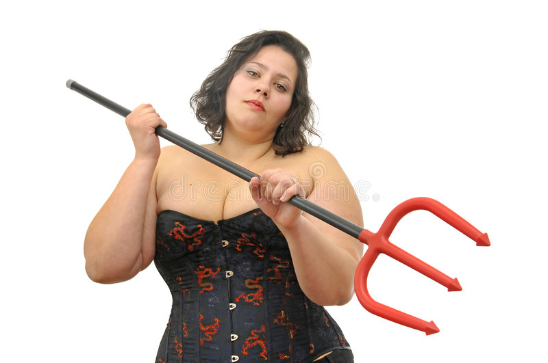 Devilish. Beautiful large young woman with devil's fork isolated in white royalty free stock photography