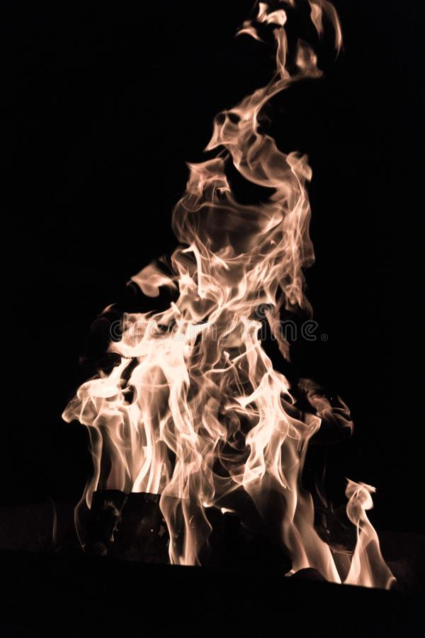 Fancy bonfire pattern. Devilish flame. The fire of hell. Background from dancing tongues of fire. Fire hazard. Fire safety. Passionate love. Bask around the stock image