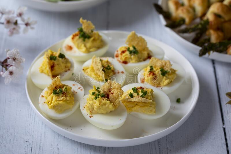 Devilled eggs canapes royalty free stock photos