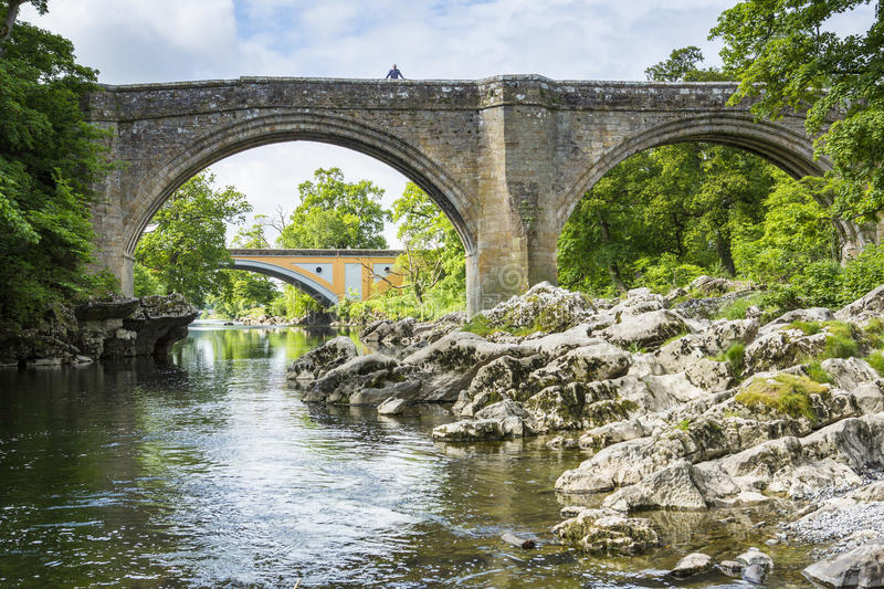 Devils Bridge near Kirkby Lonsdale, Cumbria. The Devils Bridge over the River Lune, at Kirkby Lonsdale, Cumbria, England, with the new road Stanley bridge in the stock image