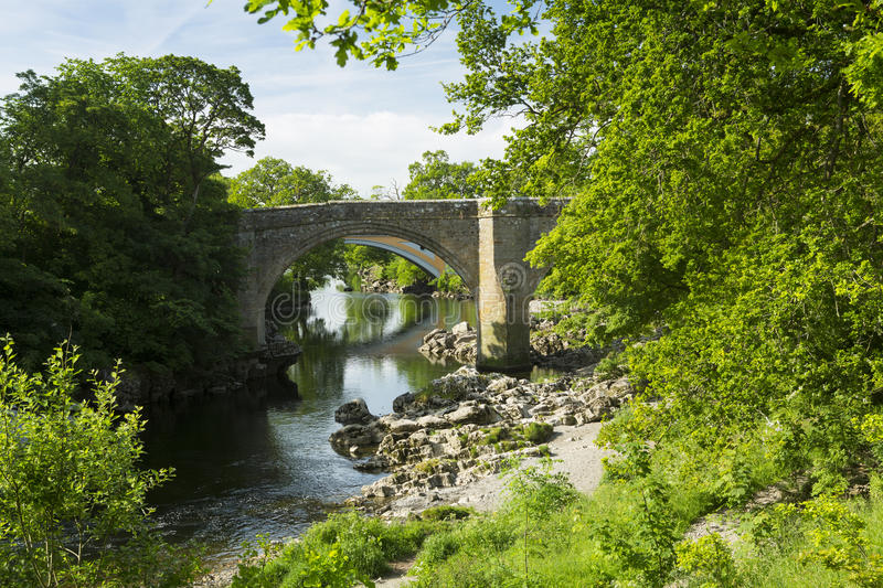 Devils Bridge near Kirkby Lonsdale, Cumbria. The Devils Bridge over the River Lune, at Kirkby Lonsdale, Cumbria, England, with the new road Stanley bridge in the royalty free stock photo