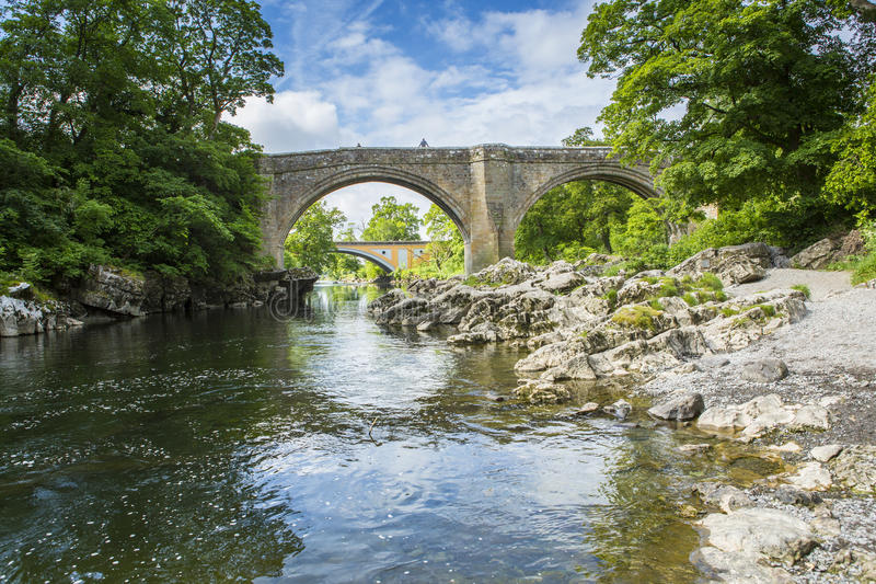 Devils Bridge near Kirkby Lonsdale, Cumbria. The Devils Bridge over the River Lune, at Kirkby Lonsdale, Cumbria, England, with the new road Stanley bridge in the stock photo