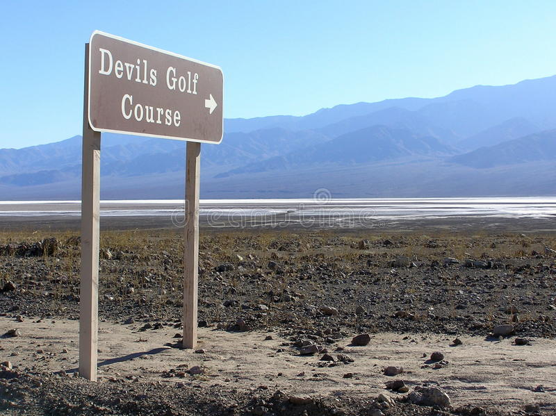 Devils Golf Course sign, Death Valley National Park. Immense area of rock salt eroded by wind and rain into jagged spires. So incredibly serrated that only the stock images