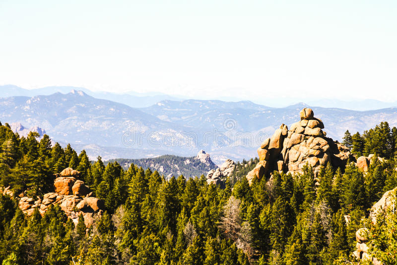 Devils head Montains. Devils head is a distinct granite rock outcropping in the front range west of Castle Rock. The outcropping is clearly visible from Castle royalty free stock photography