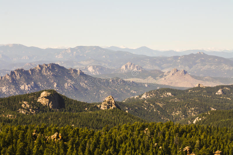 Devils Head Montains. Devils head is a distinct granite rock outcropping in the front range west of Castle Rock. The outcropping is clearly visible from Castle stock images
