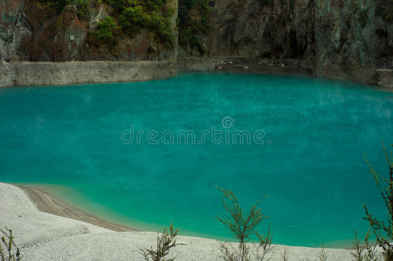 Devils Lake - Waimangu. A lake of boiling water - this turquoise colour comes from the silica makeup of the earth in the world-acclaimed Wimangu Thermal Valley stock images