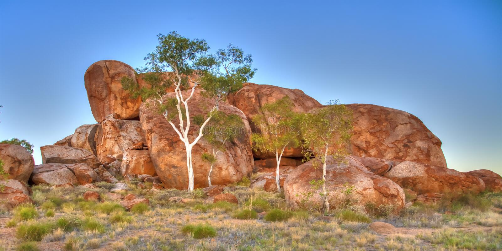 The Devils Marbles (Karlu Karlu), Northern Territory, Australia. The Devils Marbles are huge granite boulders scattered across a wide, shallow valley, 100 stock photography