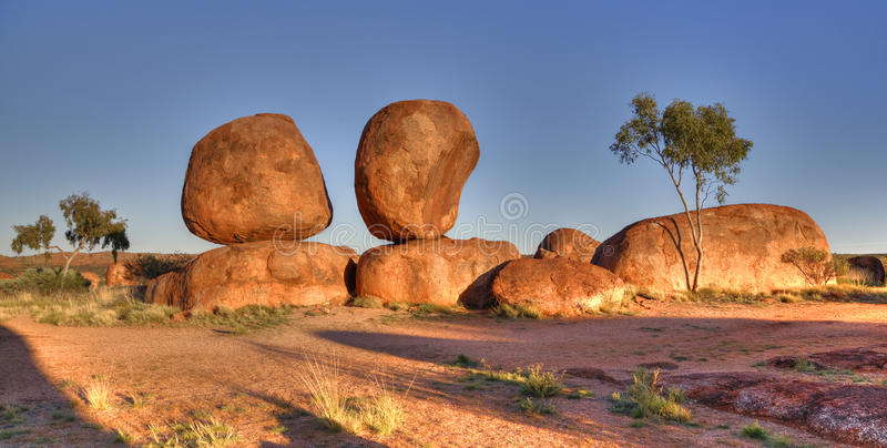 The Devils Marbles (Karlu Karlu), Northern Territory, Australia. The Devils Marbles are huge granite boulders scattered across a wide, shallow valley, 100 stock photo