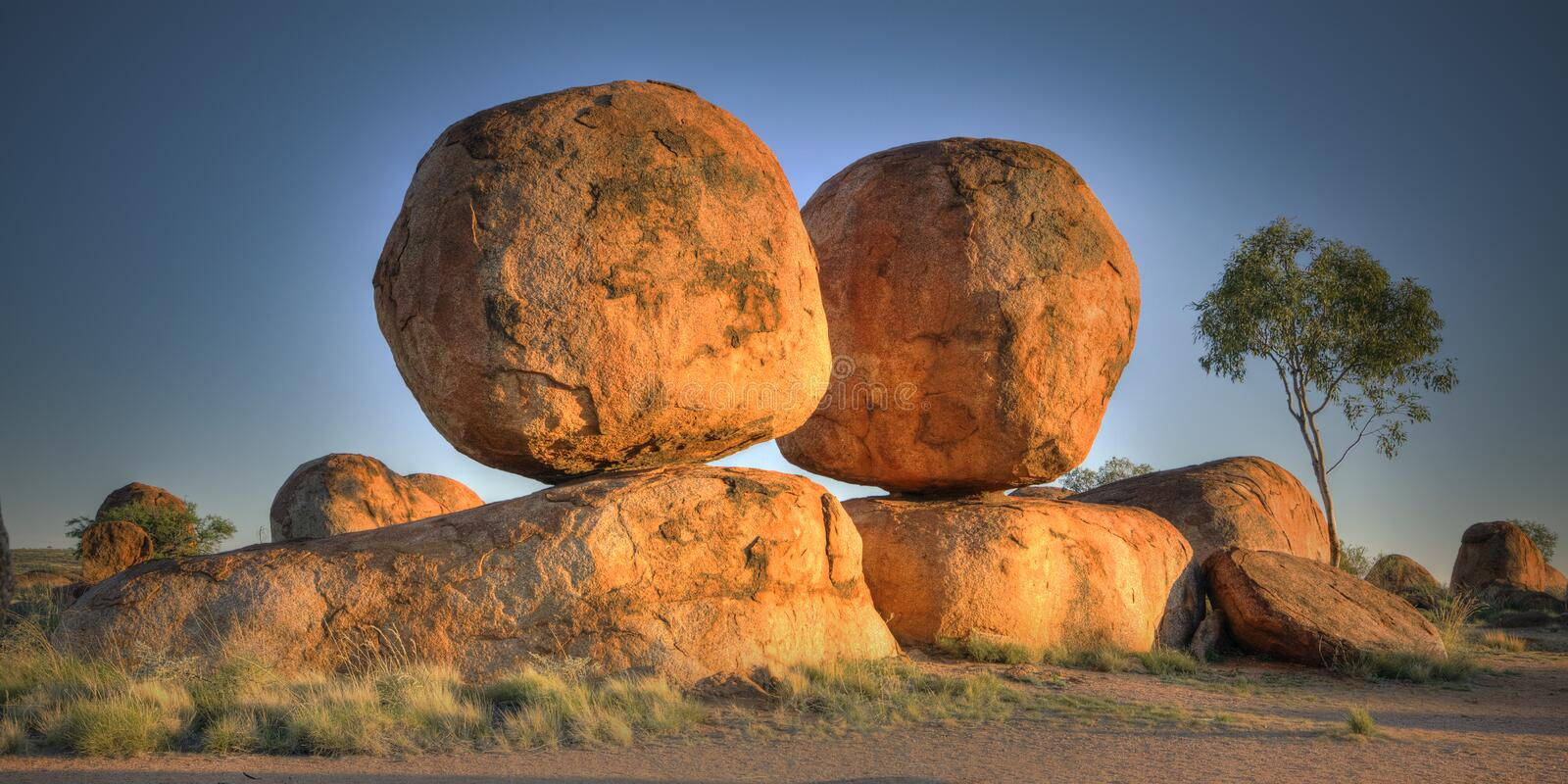 The Devils Marbles (Karlu Karlu), Northern Territory, Australia. The Devils Marbles are huge granite boulders scattered across a wide, shallow valley, 100 stock photos