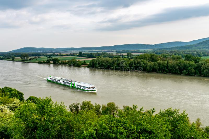 Devin Castle Slovakia 32. Devin Castle High Angle View of Ship Crossing the Danube River and Breathtaking Picturesque Landscape Sight at Background stock photo