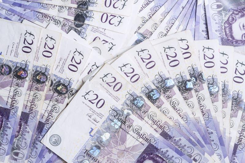 Devise britannique Fans des Anglais billets de banque de 20 livres Fond images libres de droits