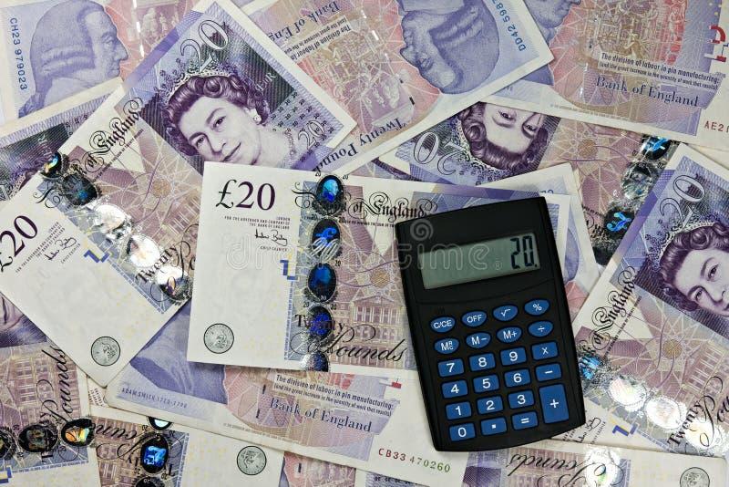 Devise de calculatrice et de l'Angleterre photo libre de droits