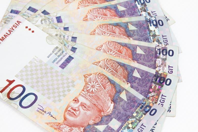 Devise de la Malaisie à l'arrière-plan blanc photographie stock libre de droits