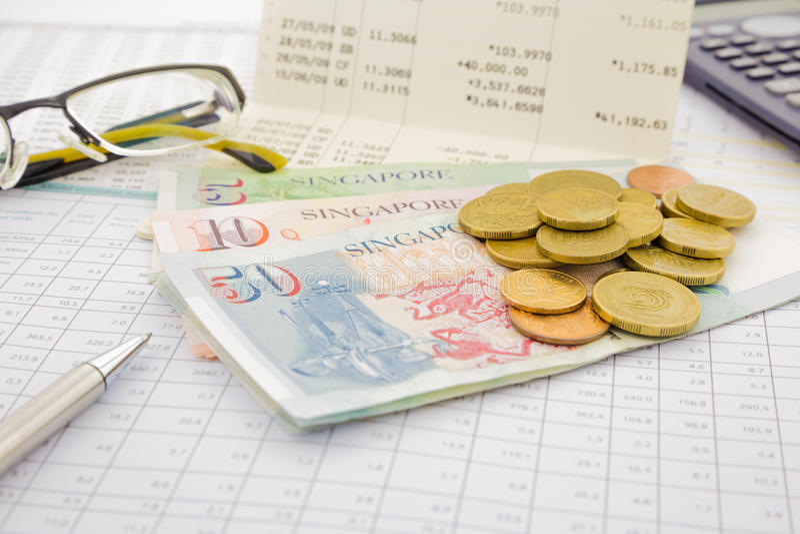 Devise et monnaie fiduciaire de Singapour photographie stock libre de droits