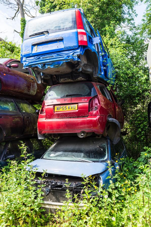 Devizes Wiltshire May 22nd 2019 a pile of 3 broken cars in a scrapyard car breakers stock image