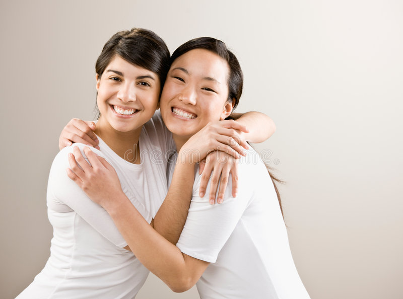 Devoted friends hugging stock image