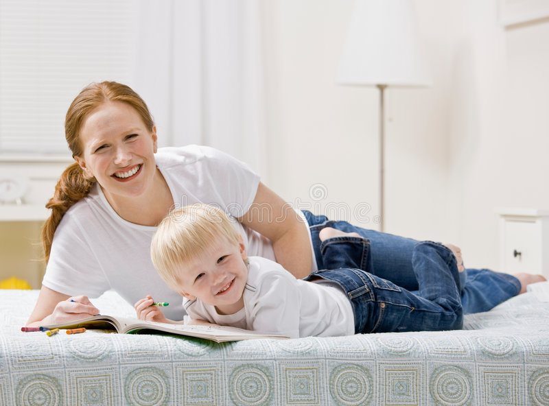 Devoted Mother Coloring In Coloring Book With Son Royalty Free Stock Images