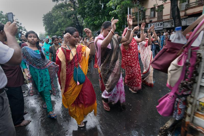 Devotees dancing a spiritual dance , on Rath yatra in Kolkata city. KOLKATA, WEST BENGAL , INDIA - JUNE 25TH 2017 : Devotees dancing spiritually on Rath yatra royalty free stock images