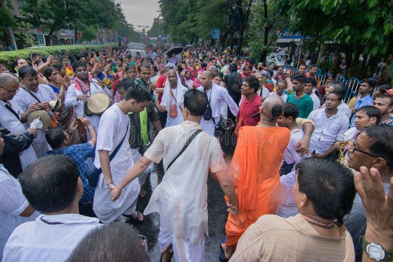 Devotees dancing a spiritual dance , on Rath yatra in Kolkata city. KOLKATA, WEST BENGAL , INDIA - JUNE 25TH 2017 : Devotees dancing spiritually on Rath yatra royalty free stock photo