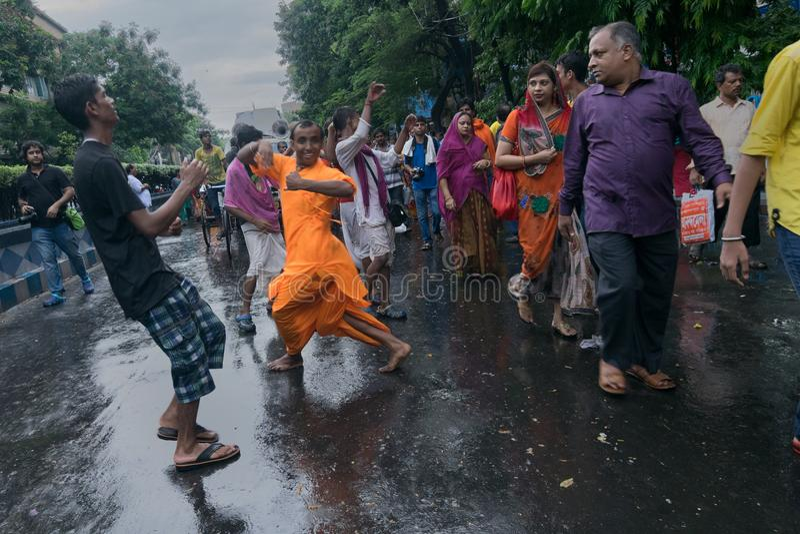 Devotees dancing a spiritual dance , on Rath yatra in Kolkata city. KOLKATA, WEST BENGAL , INDIA - JUNE 25TH 2017 : Devotees dancing spiritually on Rath yatra stock photos