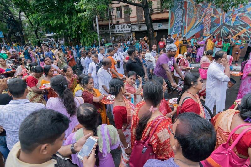 Devotees dancing a spiritual dance , on Rath yatra in Kolkata city. KOLKATA, WEST BENGAL , INDIA - JUNE 25TH 2017 : Devotees dancing spiritually on Rath yatra stock photo