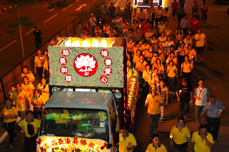Devotees following the floats at Wesak Procession