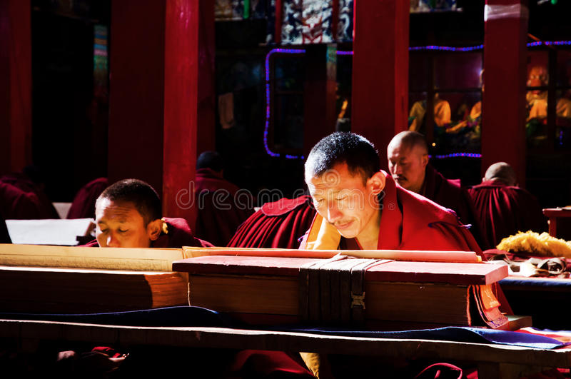 The Devout Monks. Some devout monks are reading in a big temples which is called QiangbalinSi of the Tibetan Buddhism.Which in Qamdo prefecture of Tibet royalty free stock photo