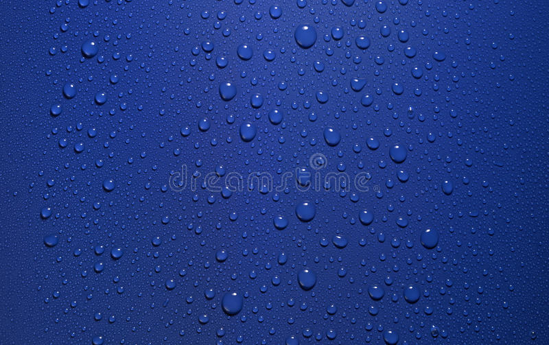 Download Dew in blue back stock image. Image of puddle, liquid - 23766661