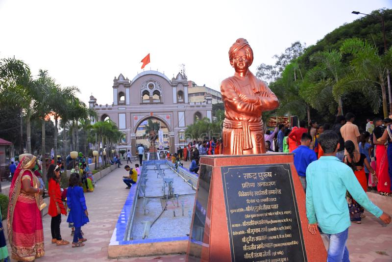 Dewas, India, 09-11-2019, the statue of Swami Vivekananda which is located in Dewas city, famous sayaji gate of dewas city in the. Background, the people of stock images