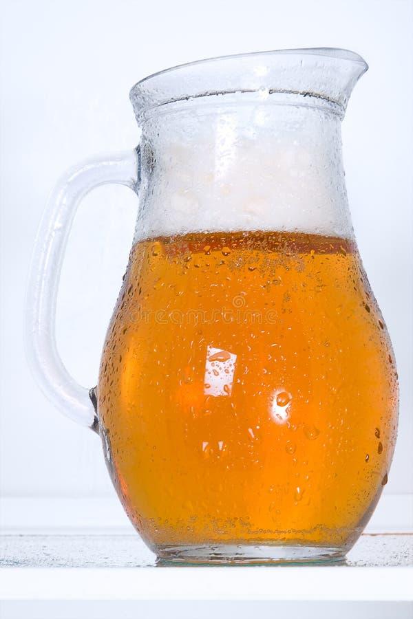 Dewy pitcher of beer. In the fridge stock photo