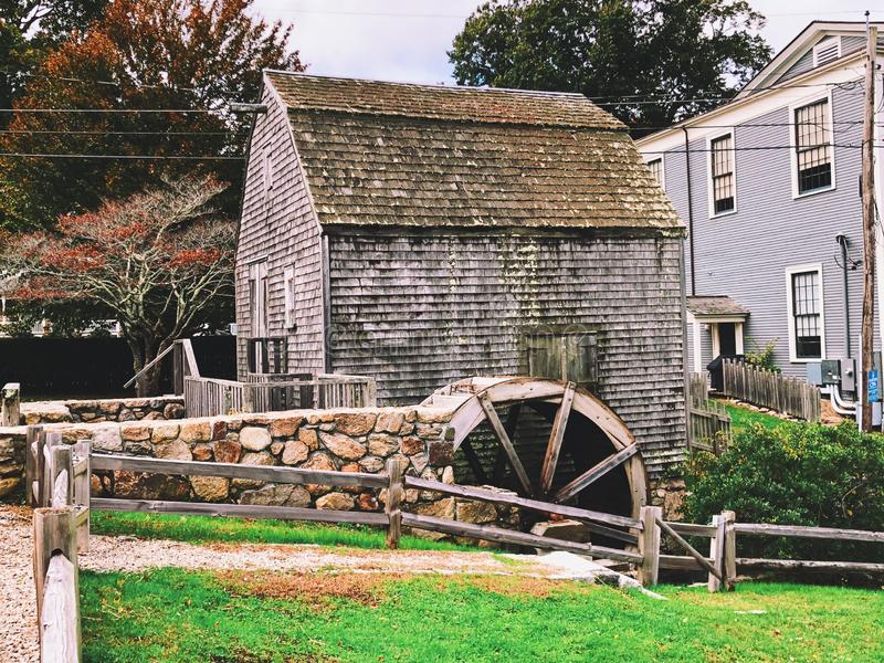 The Dexter Grist Mill in New England Sandwich. The Dexter Grist Mill the oldest mill on Cape Cod exterior located in New England Sandwich, Massachusetts, United royalty free stock photos
