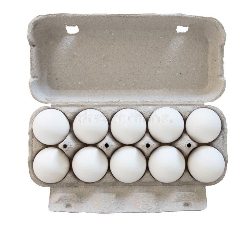 Dez ovos brancos da galinha em um pacote da caixa da caixa com uma tampa aberta Isolado no fundo branco, vista superior imagens de stock