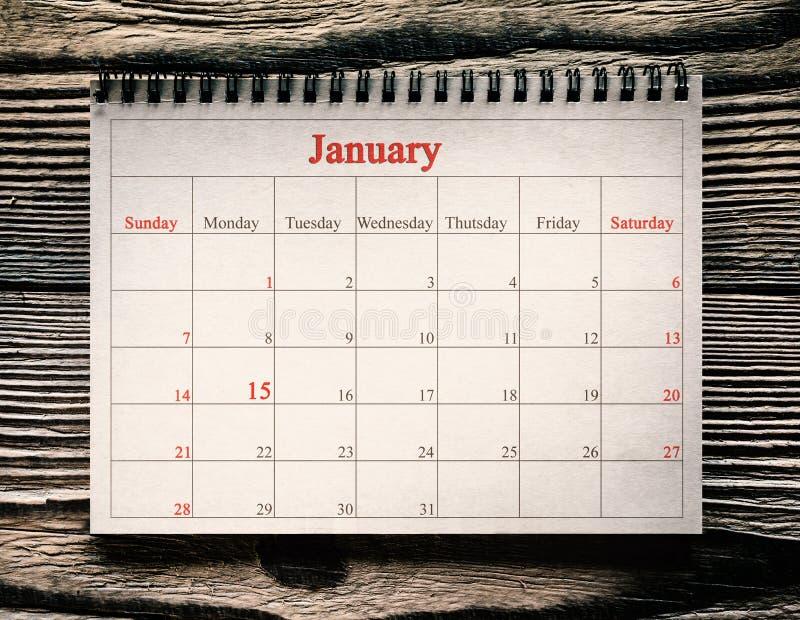 25. Dezember im Kalender auf dem hölzernen Hintergrund stockfoto