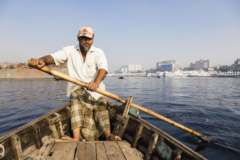 Dhaka, Bangladesh, February 24 2017: Close-up view of a rower in a taxi boat stock image