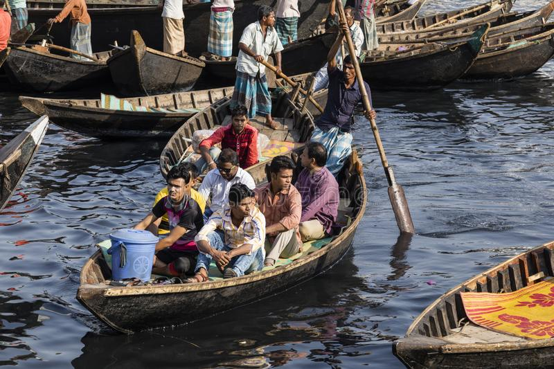 Dhaka, Bangladesh, February 24 2017: Passengers arrive in a wooden taxi boat at the terminal stock photo