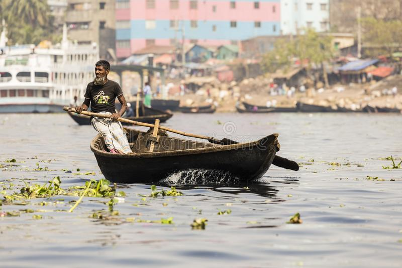 Dhaka, Bangladesh, February 24 2017: View of an old muslim rower on a river in Dhaka stock image