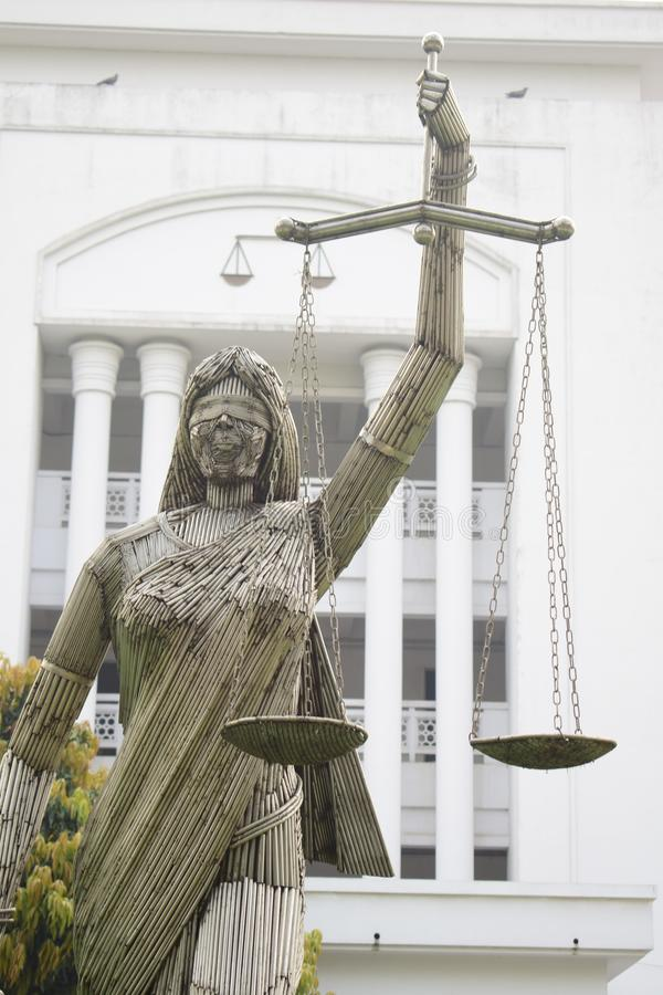 Dhaka, Bangladesh, -January, 21, 2019 : the iron made portrait of justice goddess themis in fron of supreme court. Dhaka bangladesh -january 21 2019 iron made royalty free stock photos