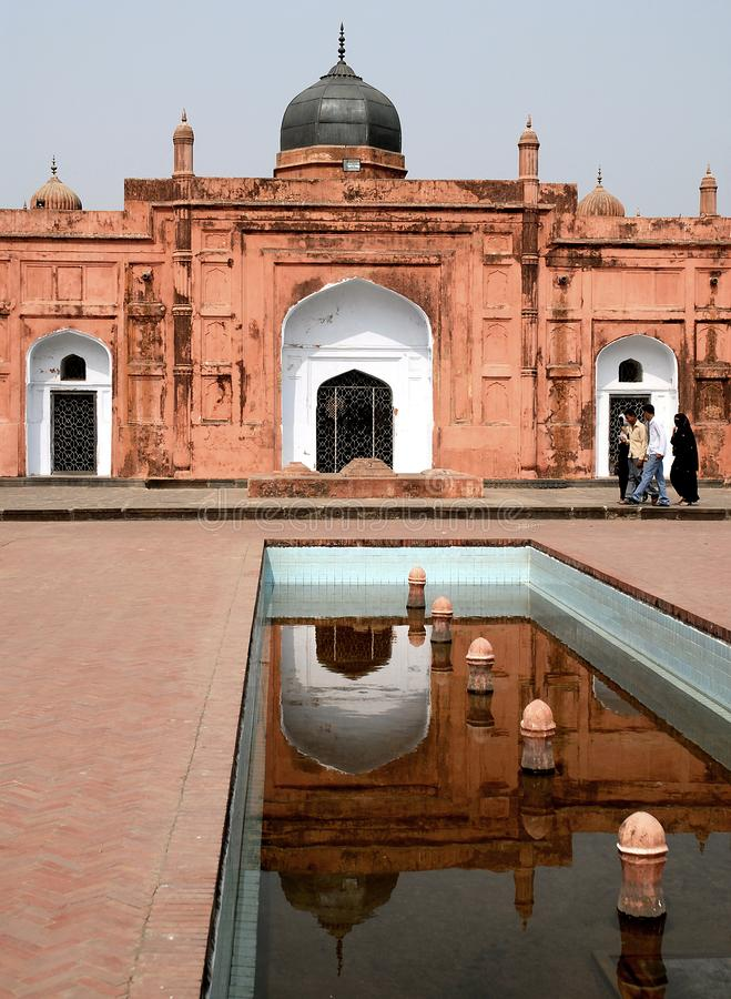 Dhaka, Bangladesh: The tomb of Bibi Pari in the grounds of Lalbagh Fort, Dhaka. People walk past Bibi Pari mausoleum and a pool. Tourist sight in Dhaka stock photos