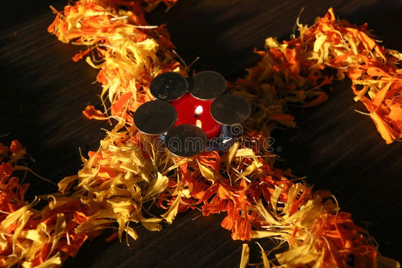 Dhanteras and diwali background.diwali greetings and wishes. Diya lit placed on swastik for celebrating diwali and dhanteras festival stock photo