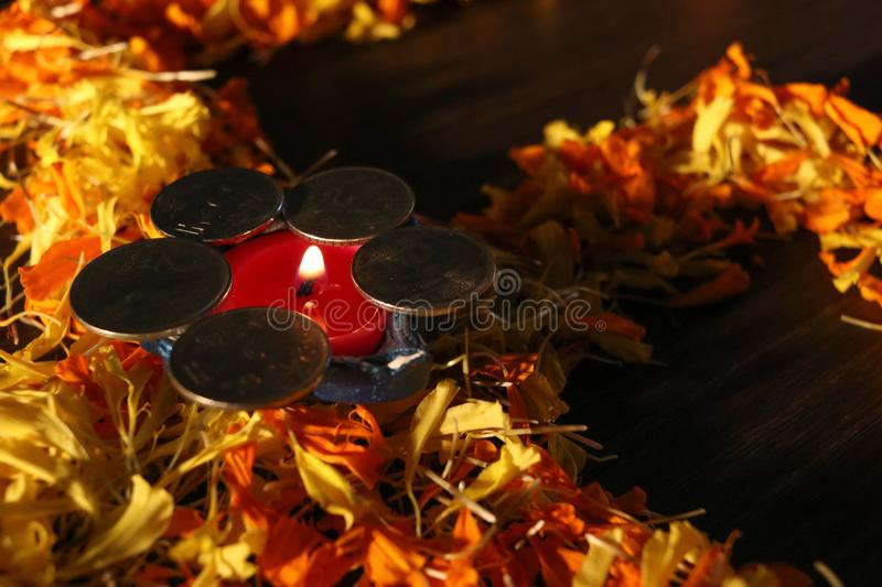 Dhanteras and diwali background.diwali greetings and wishes. Isolated diya/lamp placed on swastik for celebrating diwali and dhanteras festival royalty free stock images