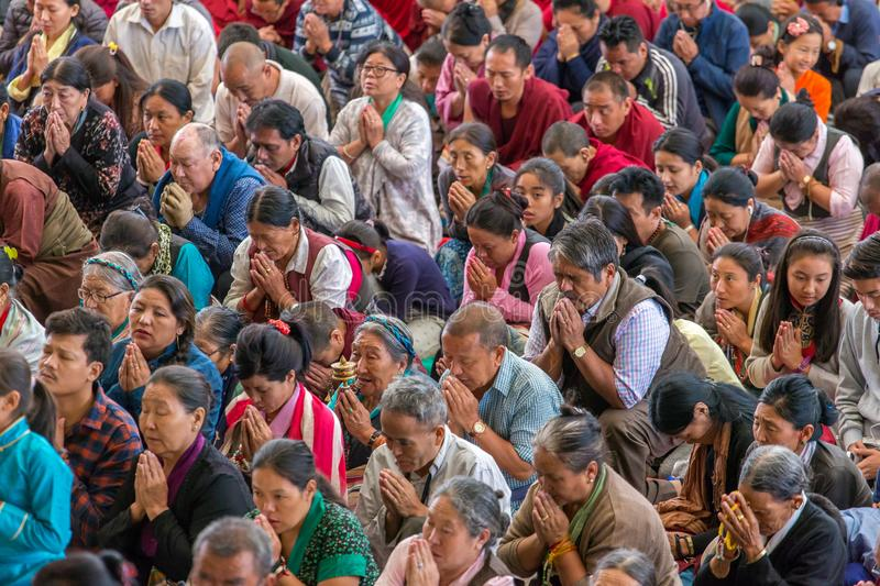 The monks and tibetan people listening to his Holiness the 14 Dalai Lama Tenzin Gyatso giving teachings in his residence in Dharam. Dharamsala, India - June 6 stock image