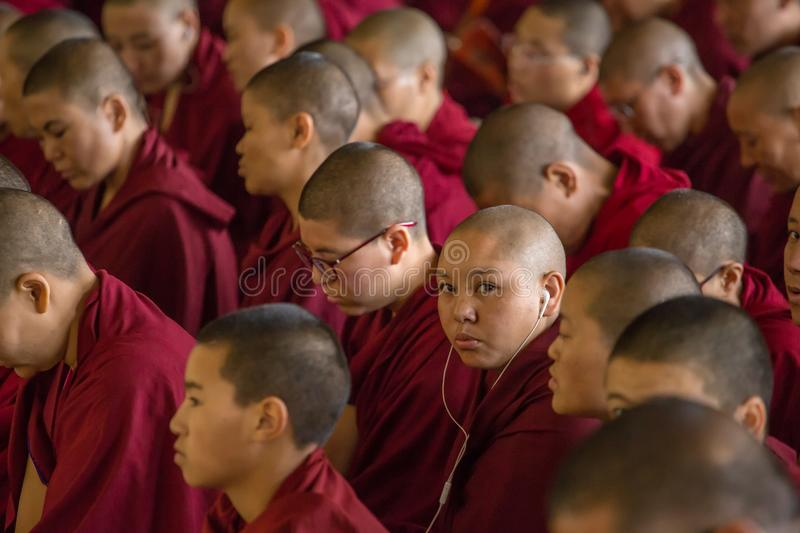The monks and tibetan people listening to his Holiness the 14 Dalai Lama Tenzin Gyatso giving teachings in his residence in Dharam. Dharamsala, India - June 6 royalty free stock photography