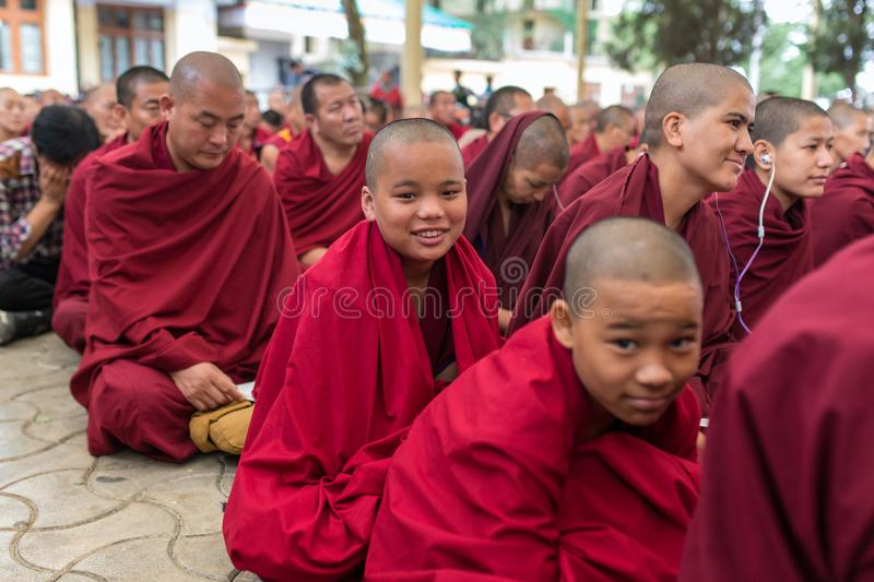 The monks and tibetan people listening to his Holiness the 14 Dalai Lama Tenzin Gyatso giving teachings in his residence in Dharam. Dharamsala, India - June 6 stock photography