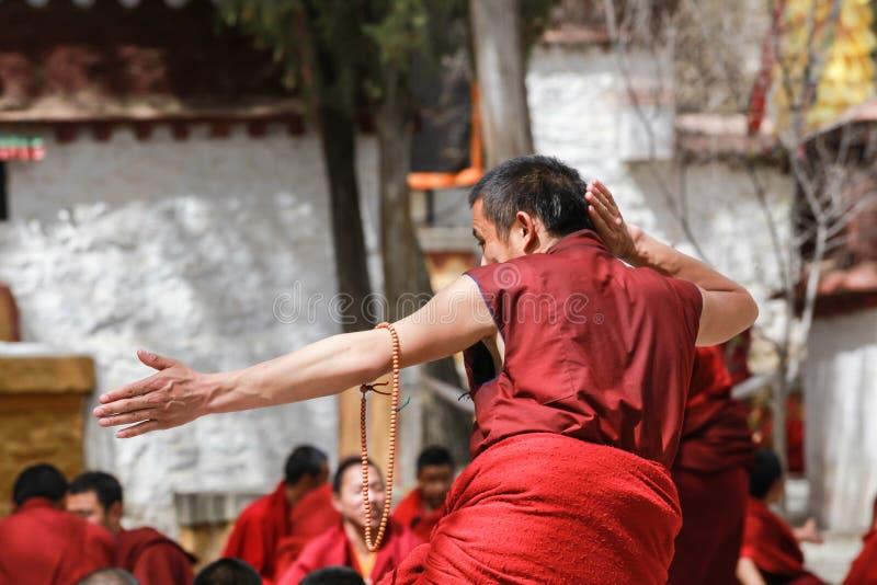 Dharma debating at Sera monastery,Tibet. Lhasa,Tibet-8 Apr 2013;Dharma debating,Tibetan buddhist lama are debating with aggressive manner in courtyard at Sera stock images