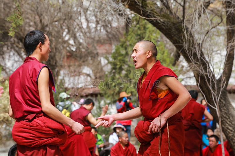 Dharma debating at Sera monastery,Tibet. Lhasa,Tibet-8 Apr 2013;Dharma debating,Tibetan buddhist lama are debating with aggressive manner in courtyard at Sera stock photos